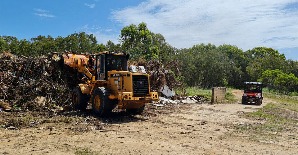 Backhoe collecting garbages